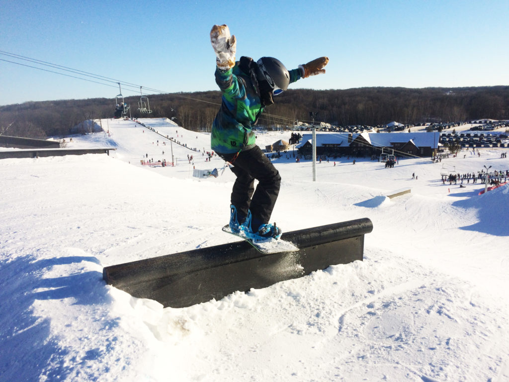 Snowboard riding a rail