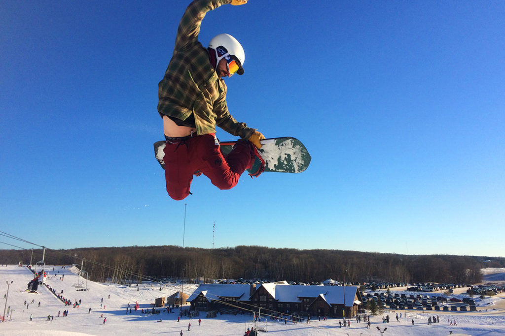 Snowboarder doing a grab trick