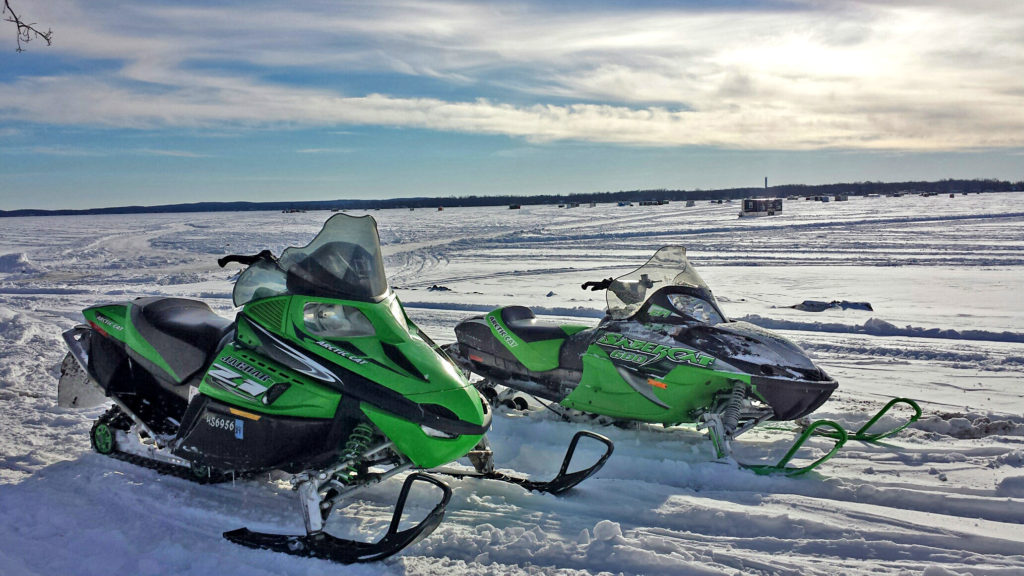 2 snowmobiles on frozen lake
